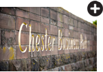 Picture of Chester Business Parks brick wall with gold writing